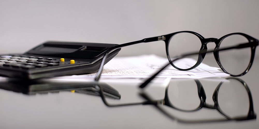 Glasses and calculator on a table