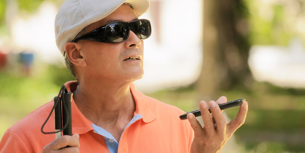 Blind man using cell phone