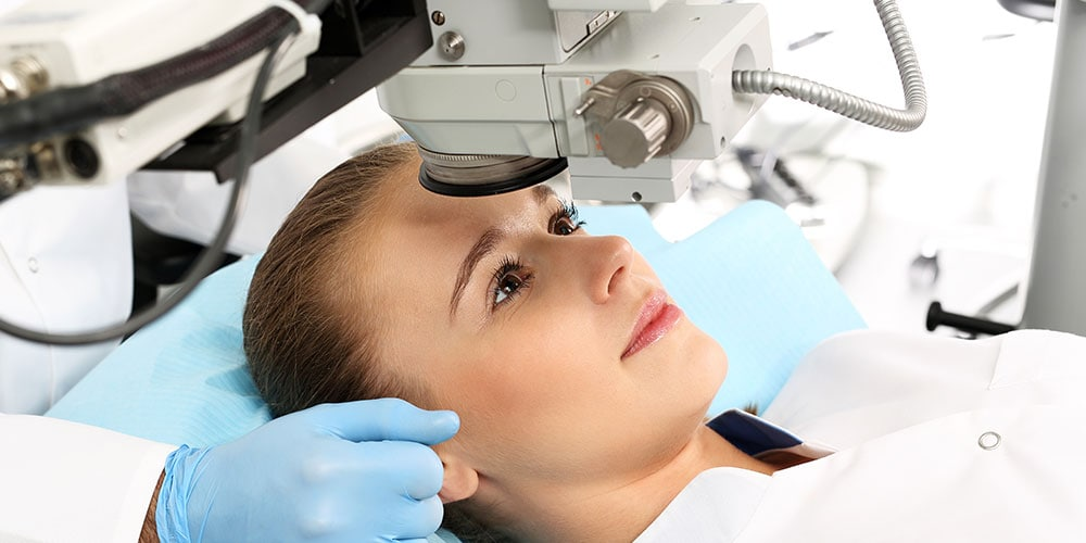 Woman receiving laser eye surgery